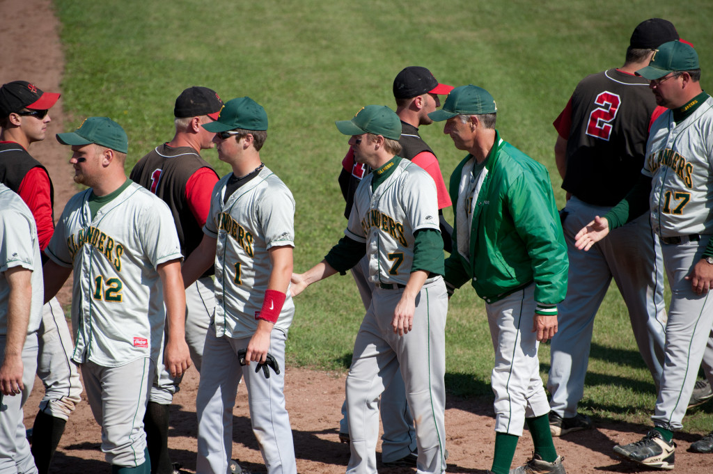 Players for the Kolberg Braves and Washington Island Islanders shake hands after a game. Photo by Dan Eggert.