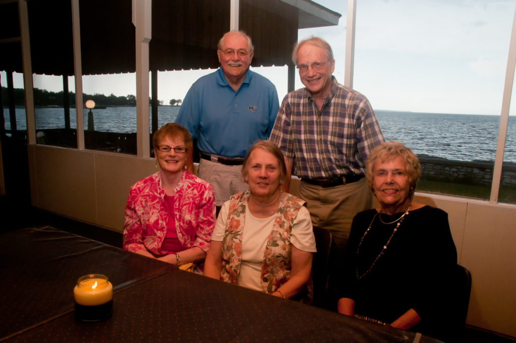 This group of LaCrosse friends returns to the Alpine every year to claim their table on the veranda and take in the resort's throwback charms. (Back row, from left) Bill Larkin and Steve Webster. (Front row, from left): Jan Larkin, Katie Webster and Carol Taebel. Photo by Taylor Schultz.