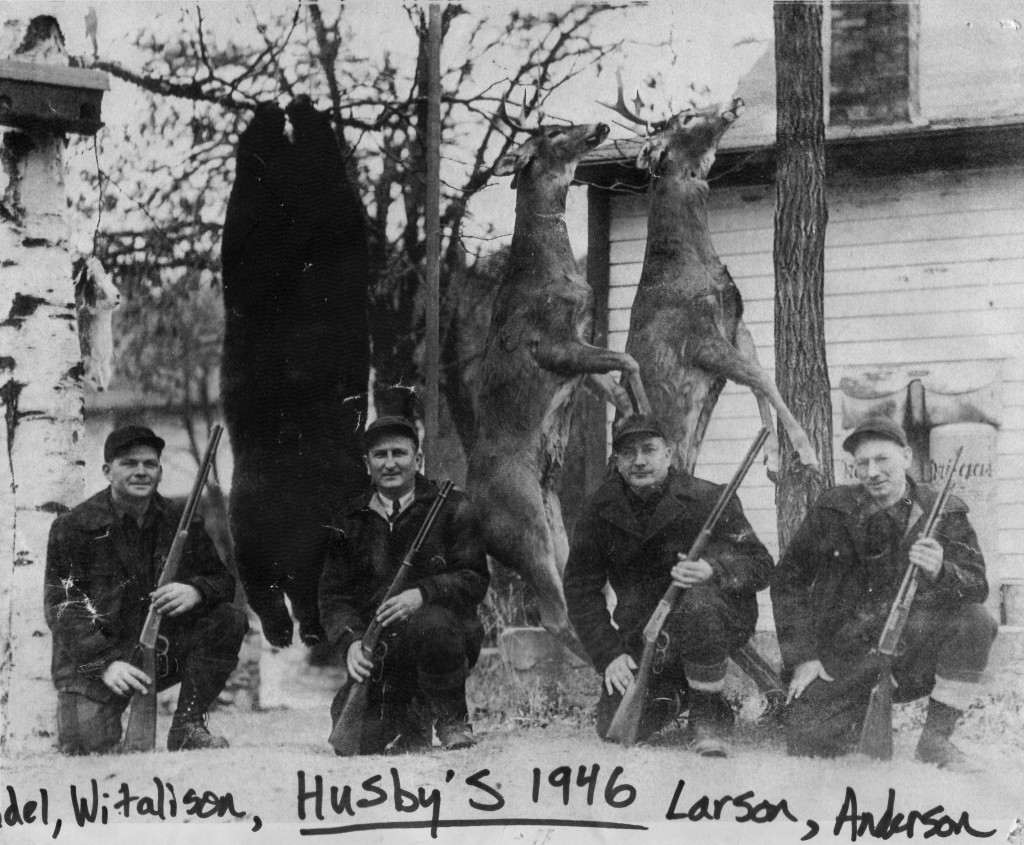Husby's hunting crew displaying trophies in 1946.