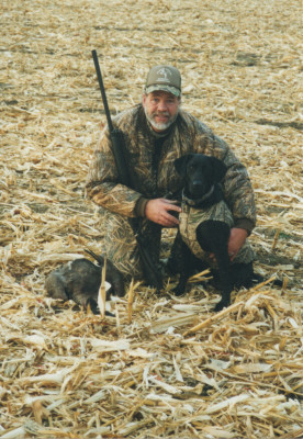 Joel McOlash, here with his hunting partner Osita, says hunting may be getting too commercialized. Photo courtesy of Joel McOlash.