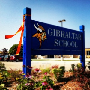 A single orange ribbon waved from the Gibraltar School sign the day Bo Johnson returned home to Sister Bay. By the next day, orange ribbons waved from nearly every Northern Door sign, mailbox, and tree. Instagram photo by Myles Dannhausen Jr.