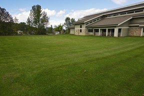 This once green stretch of lawn behind the Sister Bay-Liberty Grove Library is now an educational, sustainable, user-friendly garden. Photo by Len Villano.