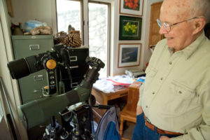 Roy Lukes shows off some of his photo equipment. The revered nature writer may be as talented with a camera as with a pen. Photo by Len Villano.