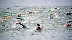 Athletes chop through the water at the Door County Triathlon. Photo by Len Villano.