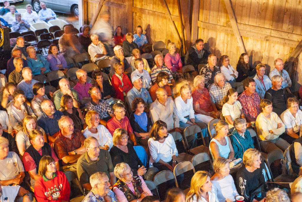 An enthralled crowd is just fine with Camp David's metal folding chairs at a Fishstock concert. Photo by Len Villano.