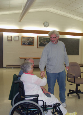 Bruce Hill shakes hands with Village of Egg Harbor residents A Decorator's Gallery owners Mary Anne and Clarence Scherer at the conclusion of the Sept. 14 meeting where Hill ended his 12-year run as a village trustee. Photo by Jim Lundstrom.