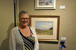 """Mac Schueppert won first place for her pastel titled, """"Wetlands at Anclam Point."""""""