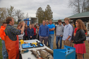 DNR fisheries biologist Nick Legler explains to a Sturgeon Bay High School ecology class the various procedures used to collect data from the spawning Chinook.