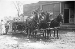 A milk wagon in front of Reynolds Store.