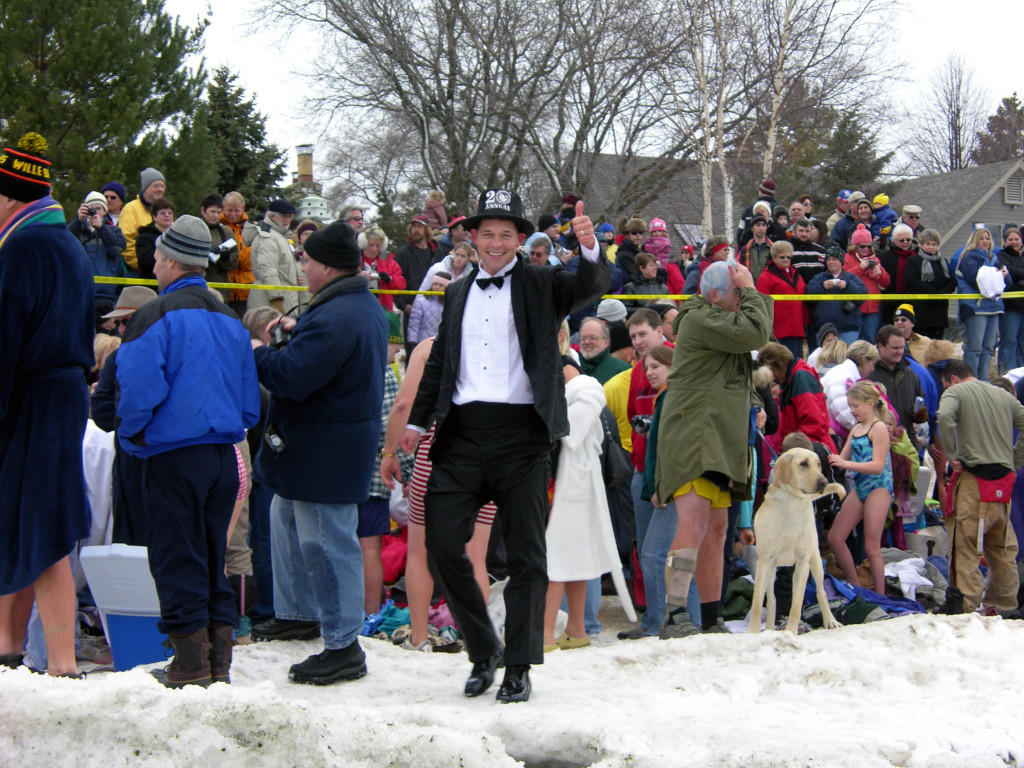 Jacksonport Polar Bear Club founder J.R. Jarosh, dressed in the tuxedo, walks the shoreline prior to the start of the 20th annual swim on January 1, 2006.