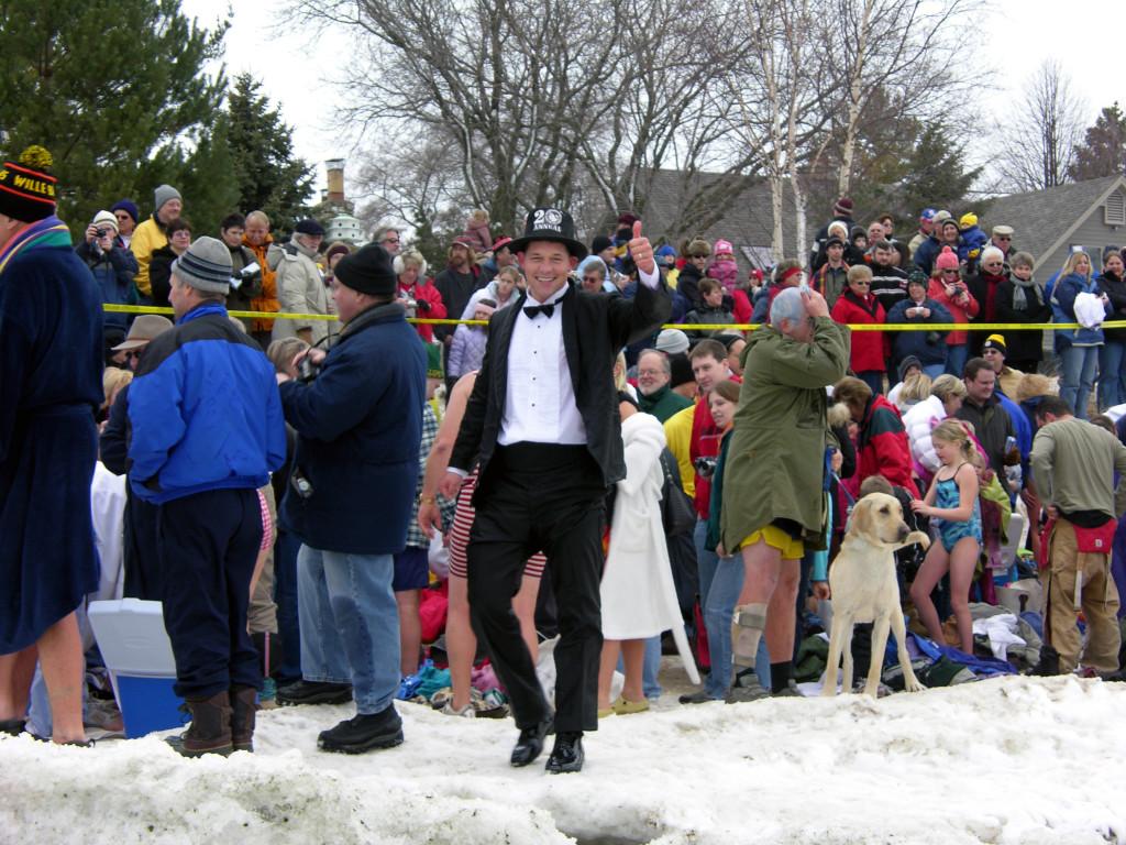 Jacksonport Polar Bear Club founder J.R. Jarosh, dressed in the tuxedo, walks the shoreline prior to the start of the 20th annual swim on January 1, 2006.