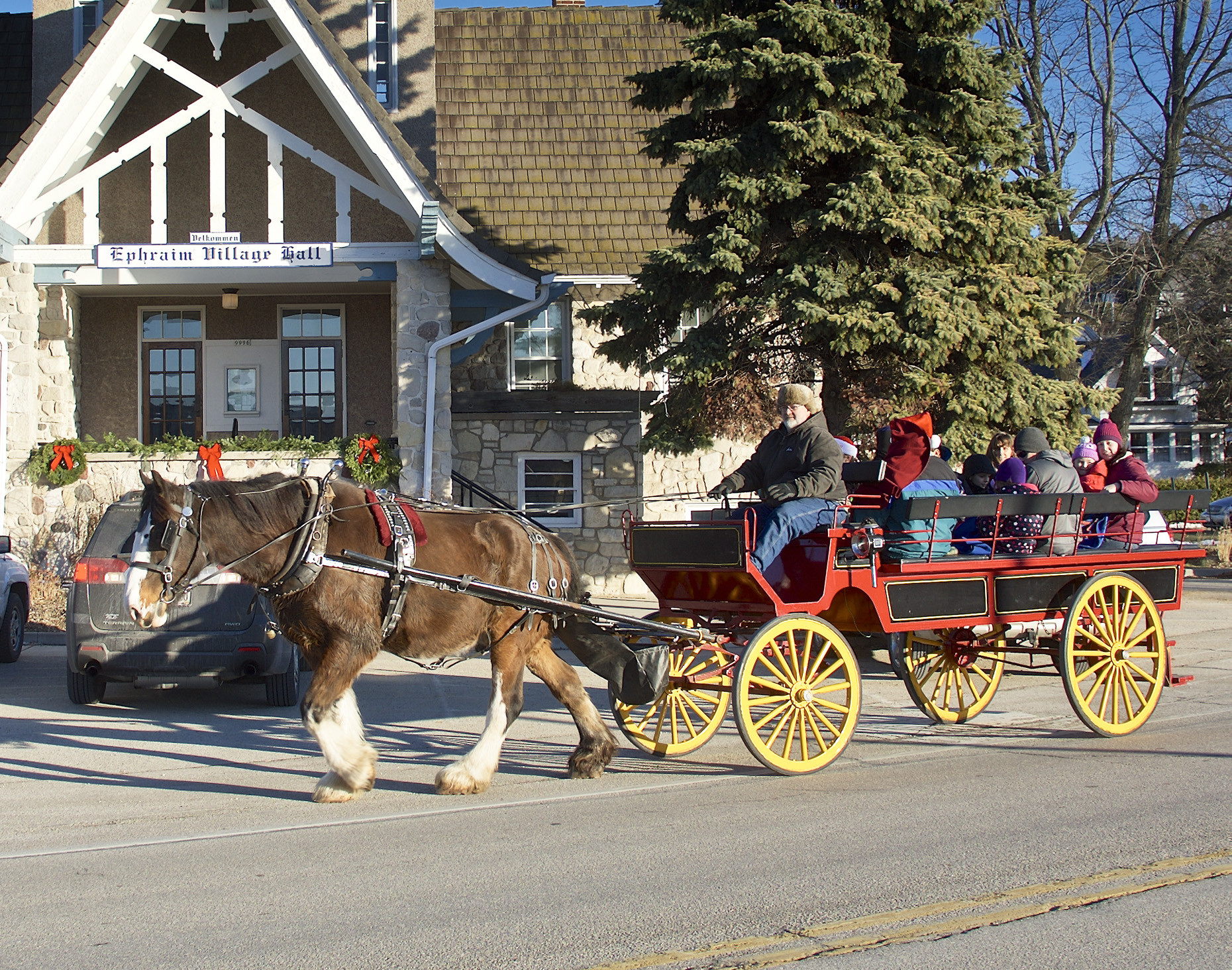 Horsedrawn carriage rides are part of the festivities in Ephraim on Saturday, Dec. 3. Photo by Len Villano.