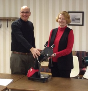 "Door Peninsula Astronomical Society President Dave Udell presents library director Rebecca Berger with four Orion ""StarBlast"" 4.5"" telescopes that will be available for checkout at the Sturgeon Bay and Sister Bay libraries in January. Submitted."
