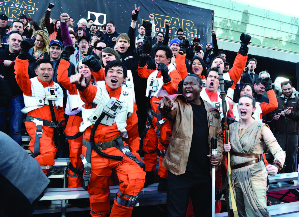 Fans attend the world premiere of Star Wars: The Force Awakens at the Dolby, El Capitan, and TCL Theatres on Dec. 14 in Hollywood, California. Photo by Alberto E. Rodriguez/Getty Images for Disney.