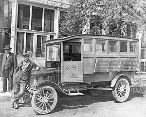 The Ford Model T bus purchased by Charley Panter to provide mail and passenger service between Baileys Harbor and Sturgeon Bay. The person leaning on the hood is probably Hank Schultz, the driver, who bought the bus from Panter. The fellow in the background looks as if he just stepped out of a nearby tavern. Photo courtesy of the Ephraim Historical Foundation collection.