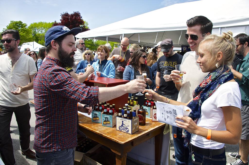 Danny McMahon of Door County Brewing Co. serves beer enthusiasts at the 2014 Door County Beer Festival in Baileys Harbor. Photo by Len Villano