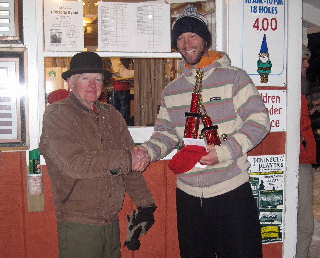 Tournaments at The Red Putter draw competitors from around the country, even in winter. Here Bob Yttri congratulates Nick Kwaterski on his Frostbite Open win on Jan. 1.