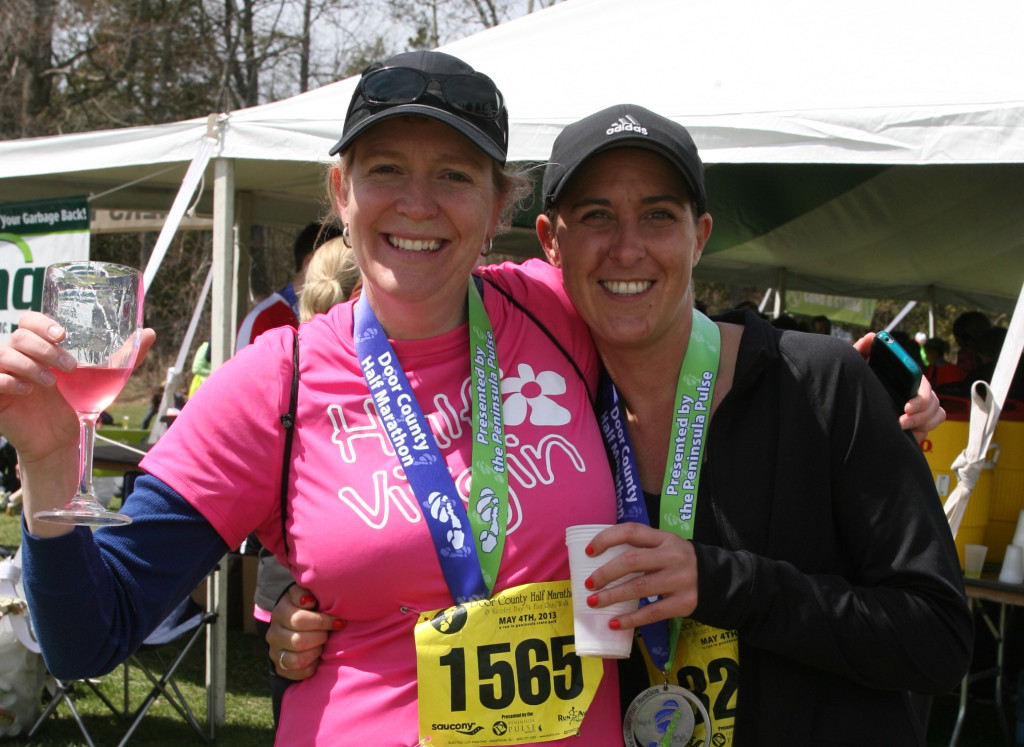 Bonnie Spielman and Michelle Daubner celebrate after finishing the 2013 Door County Half Marathon in Peninsula State Park. Photo by Len Villano.