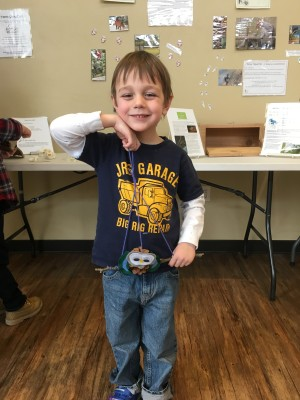 Mylo Sherman proudly displays his owl creation. Photo by Angela Sherman.