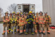 The 11 firefighter recruits and their instructors are, from left, Ethan Voeks, Gibraltar Fire Chief Jerrad Anderson, Christopher Drover, Max Maltby, Mitch Olson, Kristen Kalms, Preston Pluff, Adam Greenwood, Ashley Denman, Mason Bauldry, Alex Lensert, Mike Grubbs, and Sister Bay/Liberty Grove Assistant Fire Chief Mike Goldstone. The final class of the 60-hour entry-level firefighter course was held April 24 at the NWTC-Green Bay burn tower. Photo by Len Villano.