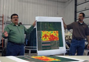 Matt Brugger and Nathan Nysse of Tilth Agronomy explained how they come up with bedrock identification maps using a Veris Soil Electrical Conductivity machine. Photo by Jim Lundstrom.