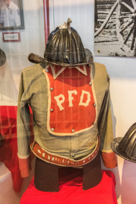 A vintage firefighting uniform can be viewed in the popular fire station portion of the museum, which also includes old firetrucks for children to sit in. Photo by Len Villano.