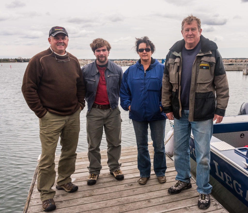 (Left to right) Keith Cormican, Abe Packard, Beth Darst and Jim Robinson at the Baileys Harbor marina.