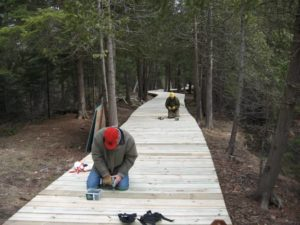 Installing the board walk. Photo by Ed Miller.