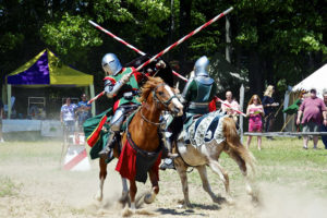 Cheer on champion knights during the joust at the Door County Renaissance Fantasy Faire. Photo by Len Villano.