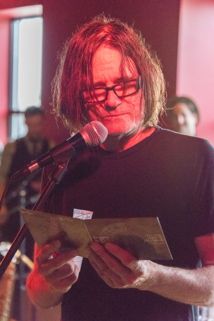 "pat mAcdonald receiving his tribute album, ""Begging His Grace: Volume One,"" at Steel Bridge Songfest 2015. Photo by Len Villano."