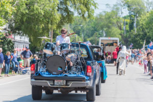 A grande parade will make its way through downtown Ellison Bay on Saturday at 11 am. Photo by Len Villano.
