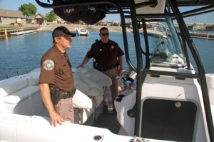 Investigator Jason Stenzel and Deputy Scott Walker are two of the seven members of the Door County Sheriff's Department who take part in marine patrol. They will be out in force this weekend with the teams from the U.S. Coast Guard as part of Operation Dry Water, a national effort to raise awareness of the dangers of drunken boating. Photo by Jim Lundstrom.