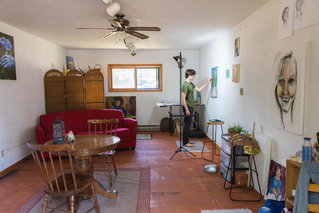 Peninsula Pulse and Door County Living creative director Ryan Miller works on a piece in his Baileys Harbor studio. Photo by Len Villano.