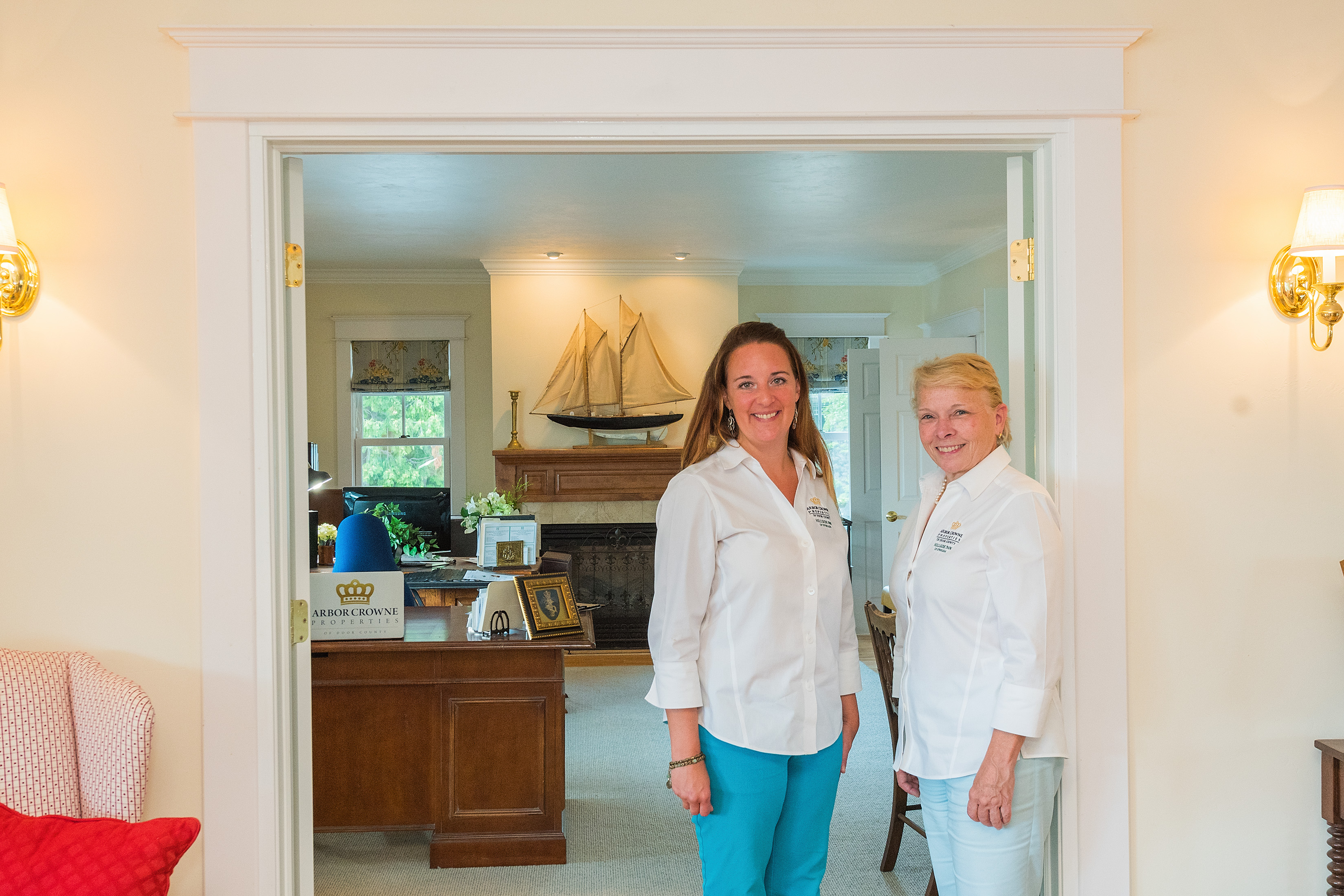 (Left to right) Carrie Counihan and Diane Taillon work at the Hillside Inn's renovated office space for Taillon's other business, Arbor Crowne Properties. Photo by Len Villano.