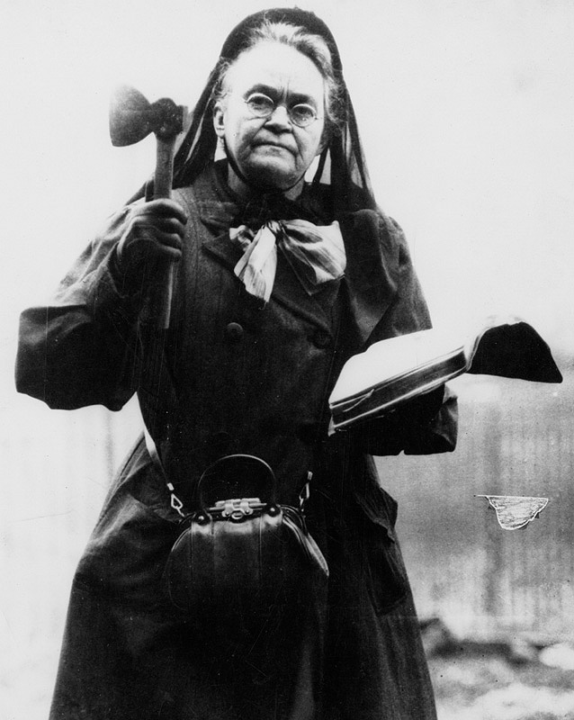 "The hatchet-wielding Carrie Nation claimed she had divine ordination to promote temperance by destroying saloons. She was arrested more than 30 times for her ""hachetations."" She is seen here in a 1910 public domain photo."