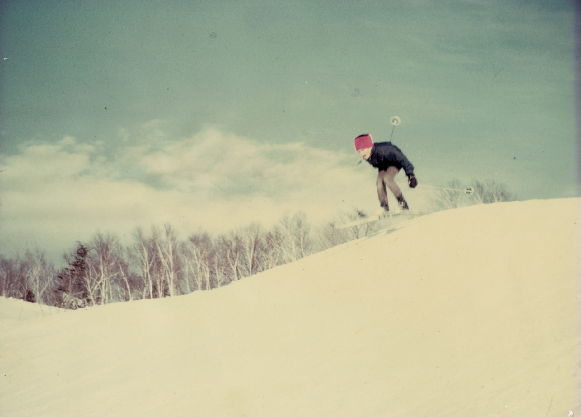 Mitch Larson gets some air at his father's Nor Ski Ridge hill in Fish Creek in the 1960s. Years later, Larson opened a sportswear store, no doubt influenced by his time on the hill.