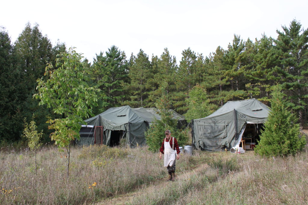 Pastor Dan Wolgast found two used military tents online to serve as the bunk house and dining hall. Photo by Jackson Parr.