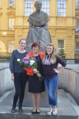 Marcy Desotelle, right, on the last day of school in the city of Do Hradce Králové in the Czech Republic, with the head teacher for her class and an exchange student from Canada.Their school is in the background, and they're in front of a statue of Bozena Nemcova, a famous author of children's books.