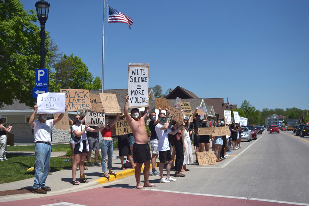 When a police officer killed George Floyd by holding his knee on Floyd's neck for seven minutes and 46 seconds on a Minneapolis street in May, it sparked nationwide protests against police brutality. Protestors expressed their support for Black Lives Matter and police reform throughout the summer in Sister Bay. Photo by Myles Dannhausen Jr.