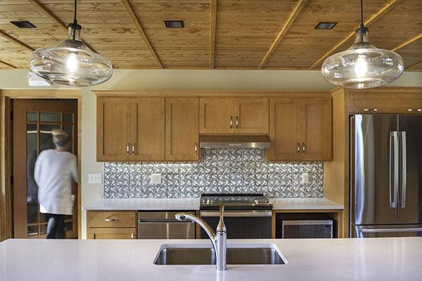 The tiles of the kitchen backsplash are the work of Ellison Bay potter David Aurelius. Photo by Wayne Reckard, Kubala Washatko Architects.