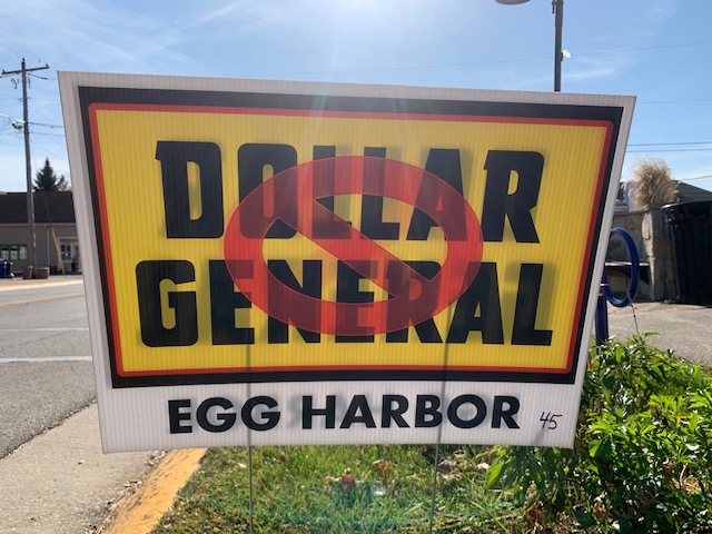 Dollar General approached the Town of Egg Harbor with plans for a new store on Highway 42. The plans required a public hearing, which the town scheduled for early November but then canceled because of COVID-19 concerns. The hearing had not been rescheduled by year's end. Meanwhile, the Eggs Against Dollar General opposition group coordinated an online petition and sign campaign in an effort to stop the chain store from moving into Northern Door. Photo by Myles Dannhausen Jr.