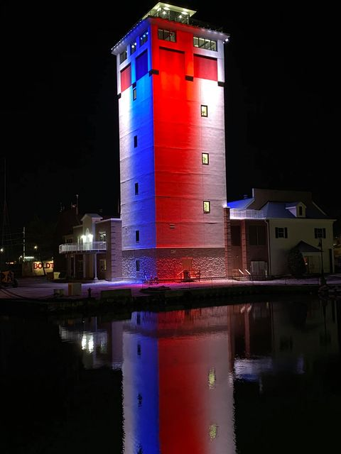 The new Door County Maritime Museum Tower lit up the Sturgeon Bay skyline on Veterans Day. Photo by Jane Moroney.