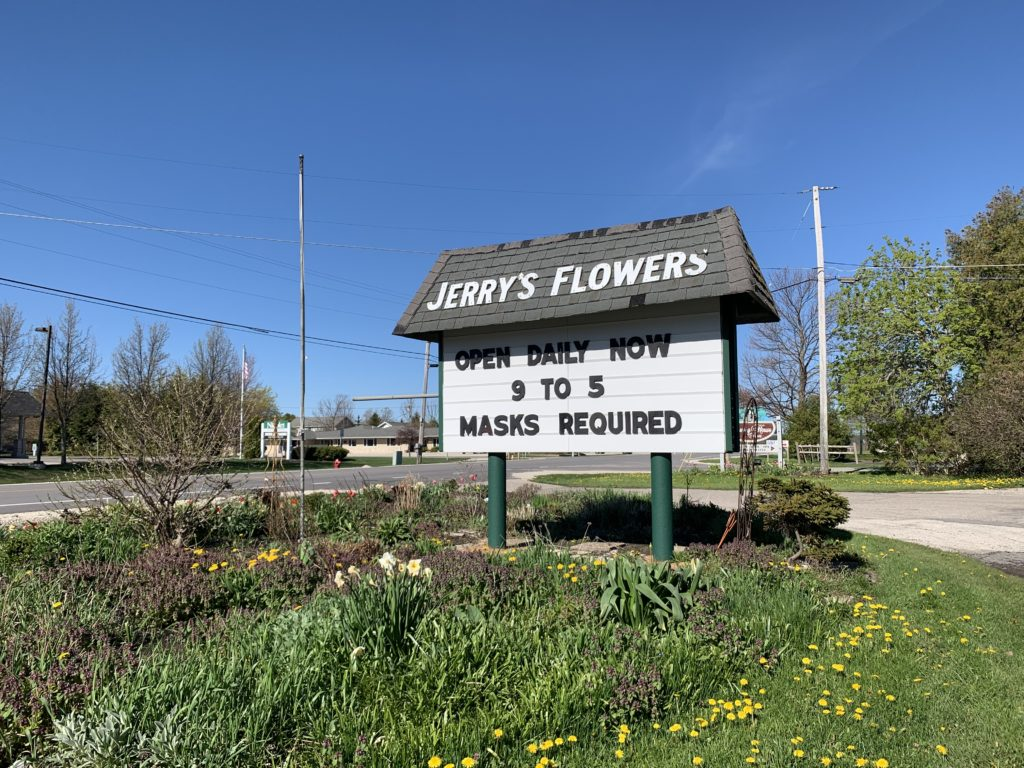 Businesses like Jerry's Flowers joined the call for mask-wearing even when the county board declined to approve a masking order. Photo by Myles Dannhausen Jr.